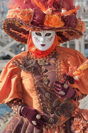 Venice, Italy - February 17, 2012: Mask posing in Saint Mark square during famous Venetian Carnival celebrations. Shot in Venice, Italy