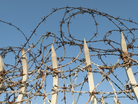 insurmountable: Barbed wire on sky