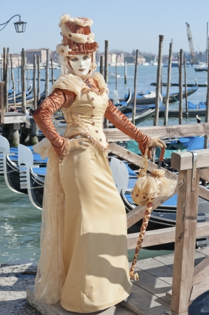 Venice, Italy - February 17, 2012: Mask posing along Saint Mark waterfront during famous Venetian Carnival celebrations. Shot in Venice, Italy Stock Photo - 17201665