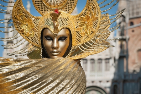 Venice, Italy - February 17, 2012: Mask posing in Saint Mark square during famous Venetian Carnival celebrations. Shot in Venice, Italy