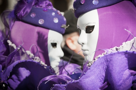 Venice, Italy - February 17, 2012: Couple of masks posing in Saint Mark square during famous Venetian Carnival celebrations. Shot in Venice, Italy Stock Photo - 17378335
