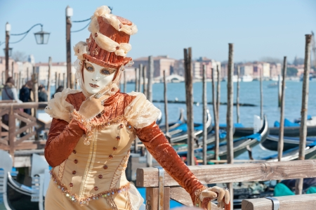 Venice, Italy - February 17, 2012: Mask posing along Saint Mark waterfront during famous Venetian Carnival celebrations. Shot in Venice, Italy Stock Photo - 17378336