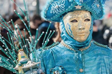 Venice, Italy - February 17, 2012: Mask posing in Saint Mark square during famous Venetian Carnival celebrations. Shot in Venice, Italy Stock Photo - 17465312
