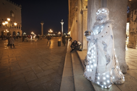 Venice, Italy - February 17, 2012: Mask posing during night in Saint Mark square during famous Venetian Carnival celebrations. Shot in Venice, Italy Stock Photo - 17712910
