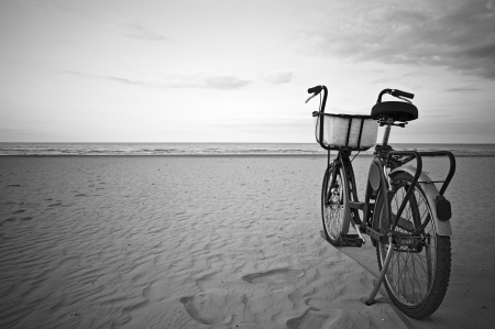 Parked bicycle along an empty beach  photo