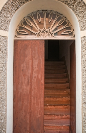 ajar: Old house door with internal stairs