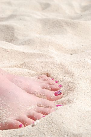 Womans Pedicured Feet in White Sand