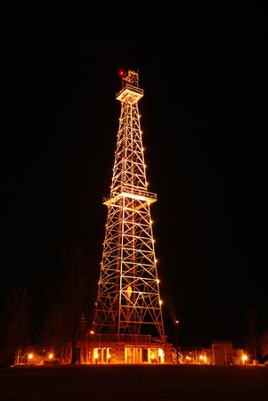 Oil Derrick at Night Stock Photo