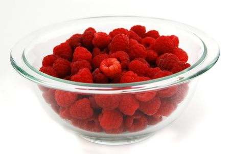 Raspberries in Bowl Isolated on White Stock Photo