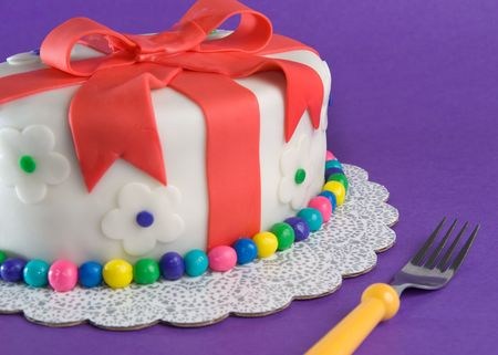 Fondant Gift Cake With Fork Stock Photo