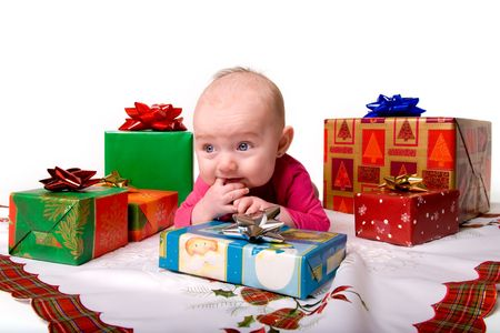 Baby Lying on Stomach Amongst Christmas Gifts Stock Photo - 5722430