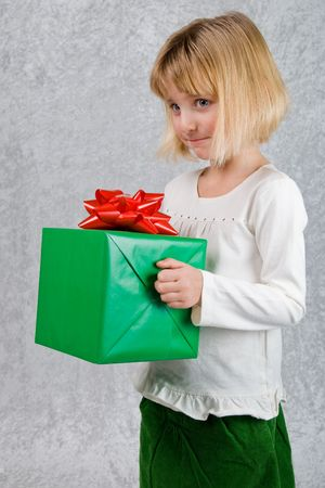 Young Girl Holds Christmas Present 1 photo