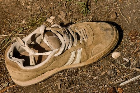 discarded: Old Discarded Shoe Stock Photo