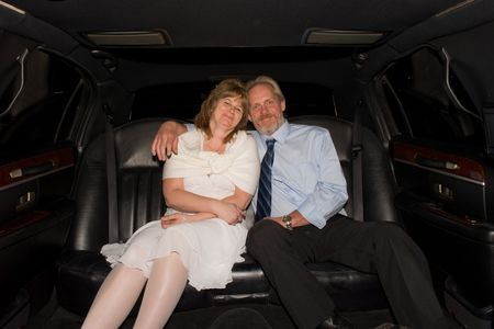 Middle-Aged Couple in Limousine
