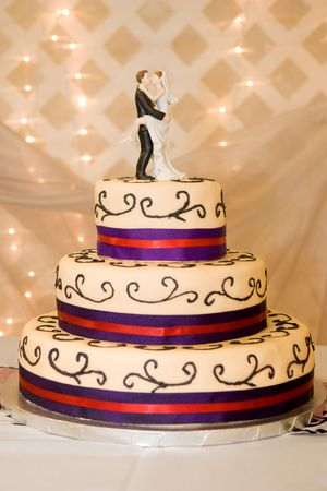 Custom Wedding Cake with Bride and Groom on Top Stock Photo