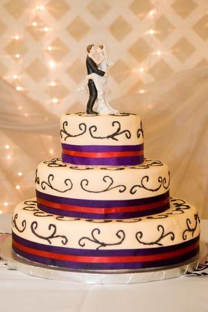 Custom Wedding Cake with Bride and Groom on Top Stock Photo