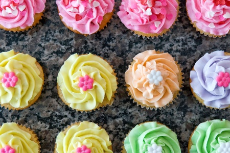 top: Rows of Pastel Colored Romantic Cupcakes