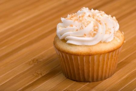 Coconut Cupcake on Bamboo Background 版權商用圖片