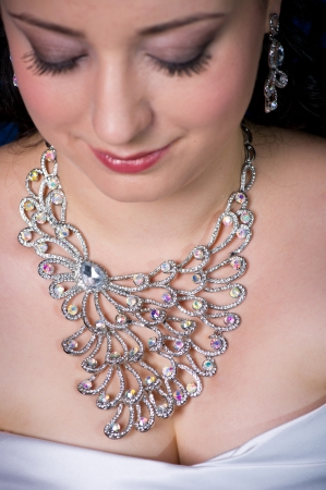 costume jewelry: Woman Wearing Elaborate Faux-Diamond Necklace