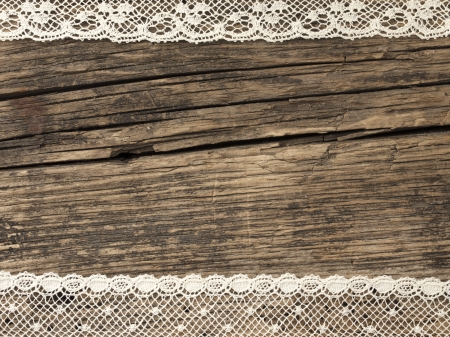 vintage lace on the wooden background photo