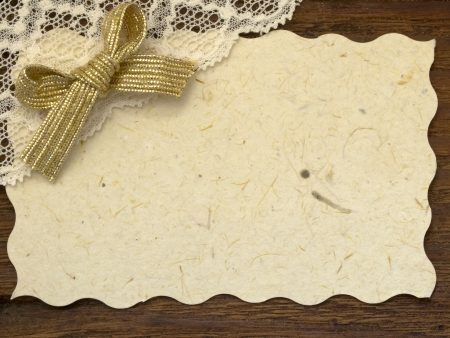 label with lace on the wood Stock Photo - 17938901