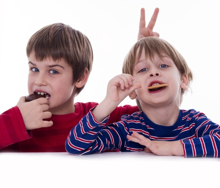 two boys eating coockies photo