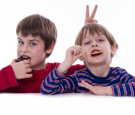 two boys eating coockies Stock Photo - 18020397