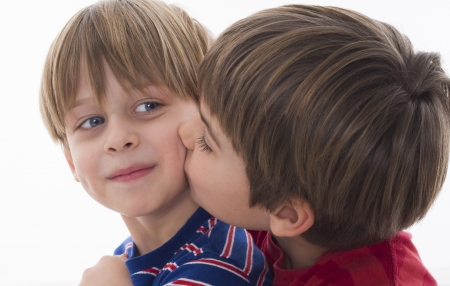 5 year old: brother s kiss Stock Photo