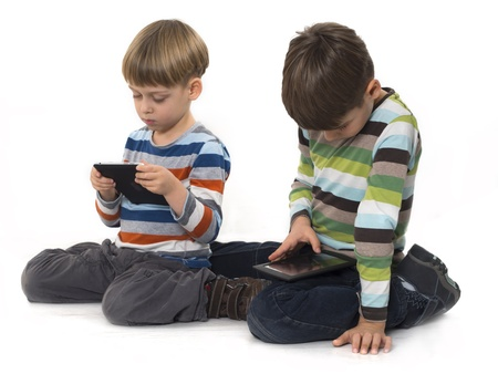 boys playing games on the tablet computers photo