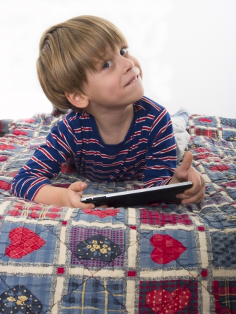 boy with tablet computer photo