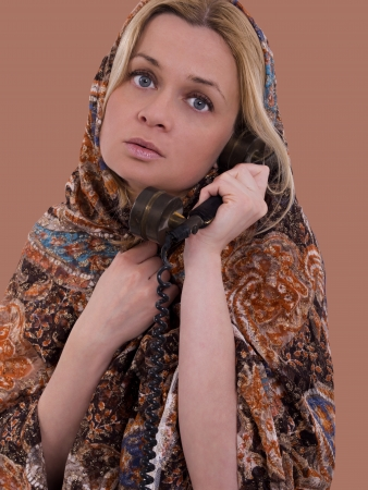 woman with headkerchief calling on phone