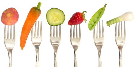 diet concept with vegetables on the forks