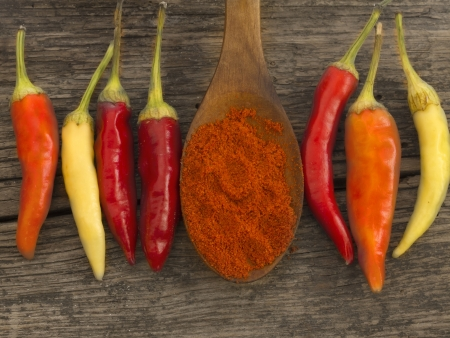 chili peppers and cayenne pepper on wooden