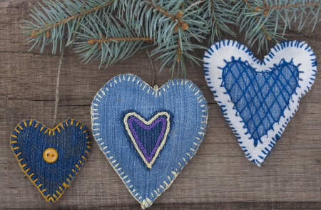 textile hearts on the wooden background photo