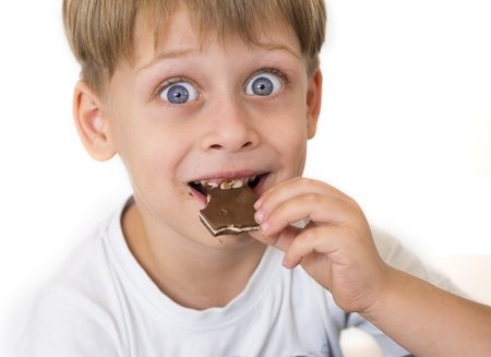 boy eating chocolate photo