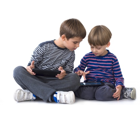 Brothers playing games on computer tablets