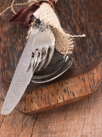 fork and knife on the wooden background photo