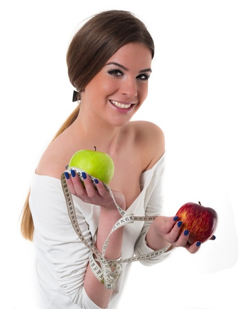beautiful young woman with fresh apples and measuring tape, diet concept