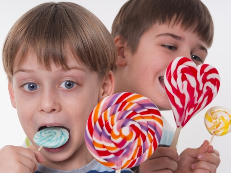happy kids with colorful lollipops  photo