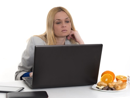 woman with laptop and fresh oranges photo