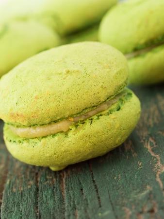 tasteful: tasteful green macaroons on wooden table Stock Photo