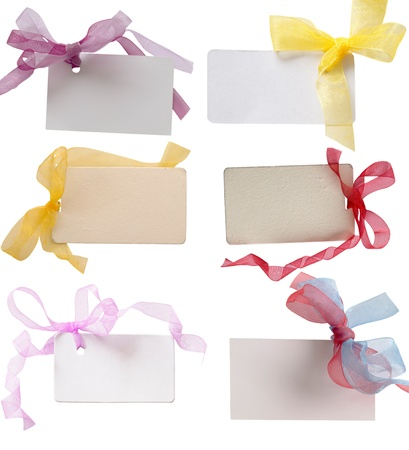 tags with beautiful colored ribbons photo