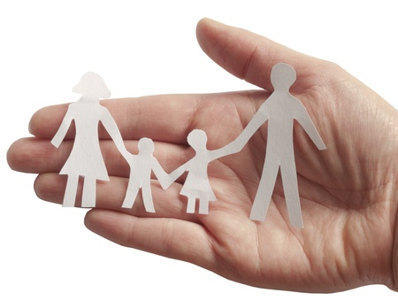 insurance concepts: family in female hand