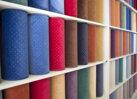 display stand: colorful carpets samples on the shelves Stock Photo