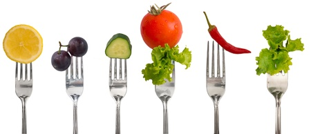 vegetables and fruits on the forks, diet concept photo