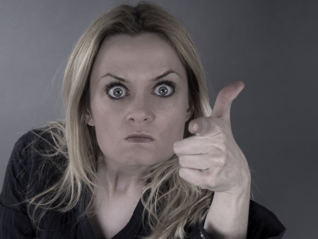 angry woman pointing photo