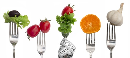 Diet concept, snack of vegetables and fruits on forks photo