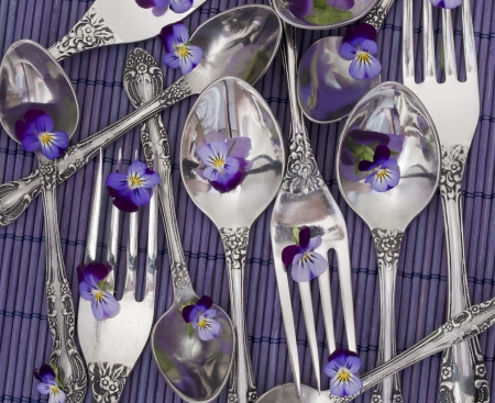 forks and spoons decorated with violets photo