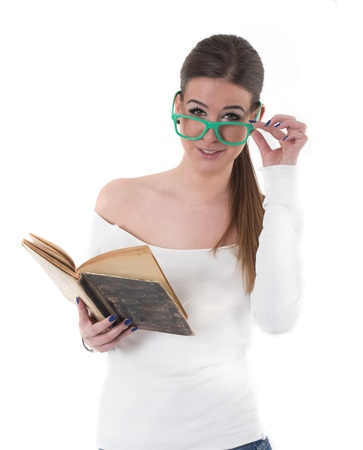 young woman with green glasses read a book, studio shot isolated Stock Photo - 22524392