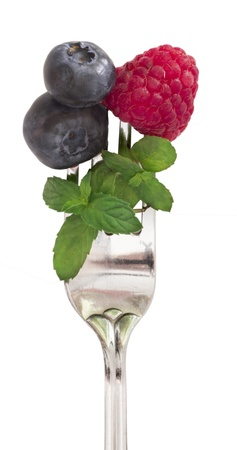 berry fruits on the fork photo